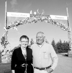 Marge and Irvin Goodon at the archway entrance to their home.
