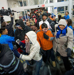 The crowd rushes into Best Buy on St. James Street this morning.