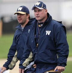 Special Teams Coordinator/Running Backs Coach Kyle Walters, left, walks with head coach Paul LaPolice at practice Monday morning.