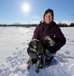 Donna Dixon, an experienced marathon runner, with her pugs, Mimi, and Milo
