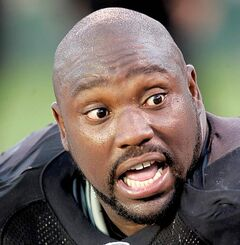 FILE - This Nov. 4, 2007, file photo shows Oakland Raiders defensive tackle Warren Sapp talking with another player on the bench in the final minutes of an NFL football game against the Houston Texans  in Oakland, Calif.  Retired NFL star Warren Sapp is asking to recover over $100,000 in a trust account left by the law firm of a man who pleaded guilty to running a Ponzi scheme. Attorneys for Sapp filed a federal court petition Monday, May 18, 2010, in Scott Rothstein's criminal case. (AP Photo/Paul Sakuma, File)