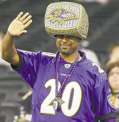 Baltimore Ravens fan Uland Price from Baton Rouge, La., waves during media day for the NFL Super Bowl XLVII football game Tuesday, Jan. 29, 2013, in New Orleans. (AP Photo/Pat Semansky)  close cut closecut