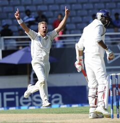 New Zealand's Neil Wagner celebrates the dismissal off his bowling of India's Zaheer Khan for 26 on the fourth day of the first cricket test at Eden Park in Auckland, New Zealand, Sunday, Feb. 9, 2014.(AP Photo/SNPA, Ross Setford) NEW ZEALAND OUT
