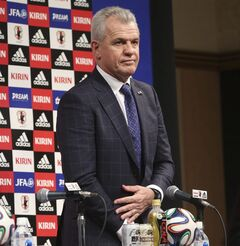 Japan's new soccer coach Javier Aguirre arrives for a press conference in Tokyo, Monday, Aug. 11, 2014. The 55-year-old Aguirre will take the reins for the Japanese side, with his first match at the helm starting with a friendly against Uruguay at Sapporo Dome on Sept. 5. (AP Photo/Koji Sasahara)