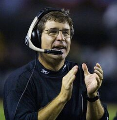 FILE - Oakland Raiders head coach Bill Callahan cheers as his team scores against the Pittsburgh Steelers in the Raiders' 30-17 win in Pittsburgh in this Sunday, Sept. 15, 2002 file photo. Former Oakland coach Bill Callahan denied allegations made by two of his former players that he