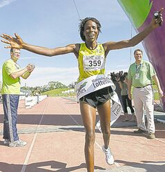 Anne Kibor crosses the finish line as the  fastest female at the Manitoba Marathon.