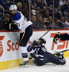 Jacob Trouba has not played since being carted off on a stretcher following this collision with the boards attempting to hit St. Louis Blues' Jordan Leopold at the MTS  Centre Oct. 18.