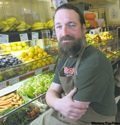 Organic Planet's Stephen Kirk makes 'a financial sacrifice in exchange for ownership.' The Wolseley grocery and deli sells organic products.