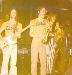 John Einarson (left) and Jim Fotheringham (right) play guitar at the Fireplace as Dave Pybus (centre) plays the saxophone in the summer of 1971.
