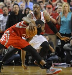 Portland Trail Blazers' Wesley Matthews (2) defends a drive by Houston Rockets' James Harden (13) during the second half of game six of an NBA basketball first-round playoff series game in Portland, Ore., Friday May 2, 2014. The Trail Blazers won the series in a 99-98 win. (AP Photo/Greg Wahl-Stephens)