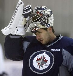 Goalie Ondrej Pavelec gets ready to rumble  as the Winnipeg Jets practise at the MTS Iceplex in preparation for road games in  Vancouver Thursday and Calgary on Friday.