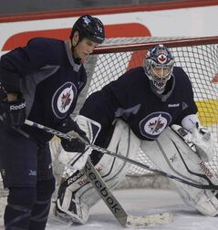Winnipeg Jets goalie Al Montoya with defenceman Adam Pardy during a pregame practice last season.