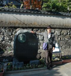 Minoru Maeda by monument marking Ranald MacDonald's contributions to Japan's history.