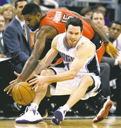 Magic guard J.J. Redick  (front) is fouled by Raptors forward Amir Johnson during first-half action in Orlando Saturday night.