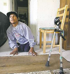30 year old Kevin Taylor who has Cerebral palsy icrawls on his floor to get to his crutches in his home in St Theresa Point First Nation- His mother Alice has filled a Human Rights  to  get proper services for her son on the reservation. Their home has no running water- See Mary Agnes No Running Water Feature � August 19, 2011   (JOE BRYKSA / WINNIPEG FREE PRESS)