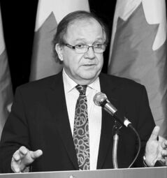 Aboriginal Affairs Minister Bernard Valcourt speaks about  his government's new plan for emergency management for First Nations in Winnipeg Tuesday.