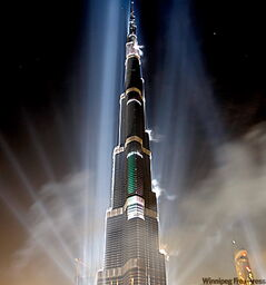 The Burj Khalifa, the world's tallest building at 828 metres, is illuminated  during the official opening ceremony in Dubai, United Arab Emirates, on Jan. 4.