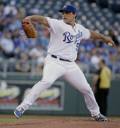 Kansas City Royals starting pitcher Jason Vargas throws during the first inning of a baseball game against the Chicago White Sox on Monday, May 19, 2014, in Kansas City, Mo. (AP Photo/Charlie Riedel)