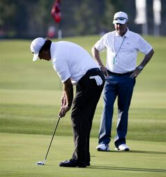Phil Mickelson, left, putts as Dave Stockton watches on the practice green before a practice round for the U.S. Open golf tournament in Pinehurst, N.C., Tuesday, June 10, 2014. The tournament starts Thursday. (AP Photo/David Goldman)