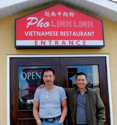 Phuc Huynh (left) and Lap Nguyen took over the former Chave d'Ouro and have reopened it as Pho Linh Linh, their new Vietnamese restaurant.