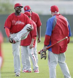 Philadelphia Phillies first baseman Ryan Howard, left, stretches with teammates during spring training baseball practice Thursday, Feb. 13, 2014, in Clearwater, Fla. (AP Photo/Charlie Neibergall)