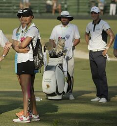 LPGA players Michelle Wie and Jessica Korda walks with Martin Kaymer, of Germany, right, the last group during the final round of the U.S. Open golf tournament in Pinehurst, N.C., Sunday, June 15, 2014. The women's U.S. Open golf tournament starts Thursday on the same course. (AP Photo/Charlie Riedel)