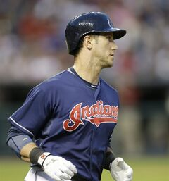 Cleveland Indians' Yan Gomes runs to first base after hitting an RBi-single off Seattle Mariners starting pitcher Hisashi Iwakuma in the fifth inning of a baseball game Tuesday, July 29, 2014, in Cleveland. Nick Swisher scored. (AP Photo/Tony Dejak)