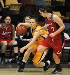 The Bisons' Christina Fischer (left) tries to elude the Wesmen's Megan Noonan at the Investors Group Athletic Centre.