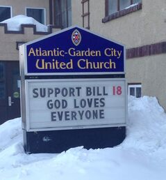 A sign posted outside the Atlantic-Garden City United Church in north Winnipeg supports the provincial anti-bullying bill.