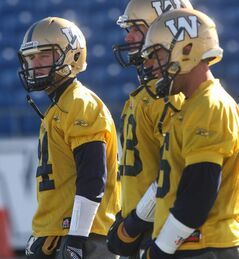 Winnipeg Blue Bombers quarterback Joey Elliott, left with quarterbacks Justin Goltz, center, and RJ Archer at practice Thursday morning at Canad Inns Stadium in Winnipeg