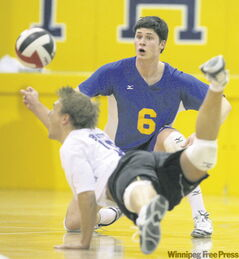 Cam Blewett of the seventh-ranked Brandon Bobcats dives for the ball in front of teammate Paul Robidoux.