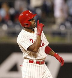 Philadelphia Phillies Jimmy Rollins reacts after hitting a double in the ninth inning of a baseball game against the Chicago Cubs to tie Mike Schmidt for career hits, Friday, June 13, 2014 at Citizens Bank Park in Philadelphia. ( AP Photo / The Philadelphia Inquirer, Ron Cortes)