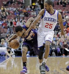 Phoenix Suns' Ish Smith (3) drives the ball up court as Philadelphia 76ers' Elliot Williams (25) defends in the first half of an NBA basketball game, Monday, Jan. 27, 2014 in Philadelphia. (AP Photo/H. Rumph Jr.)