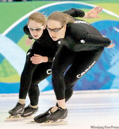 Winnipeg speedskaters Cindy Klassen (right) and Brittany Schussler practise at the Olympic Oval in Richmond on Tuesday.