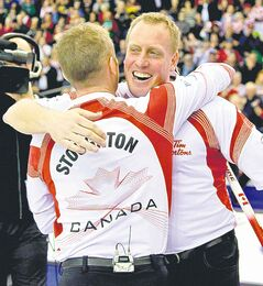 Jeff Stoughton and Steve Gould celebrate their 2011 men's world title in Regina.