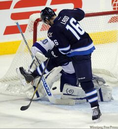 Andrew Ladd scores the fourth goal against the Lightning.