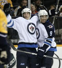 Winnipeg Jets right wing Spencer Machacek, left, celebrates with Evander Kane after scoring against the Nashville Predators in the first period of a preseason NHL hockey game on Saturday, Sept. 24, 2011, in Nashville, Tenn. (AP Photo/Mark Humphrey)