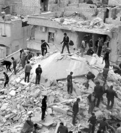 Citizens search for bodies in the rubble of buildings hit by Syrian forces.
