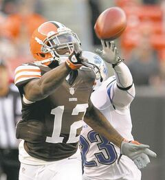 Detroit Lions' Chris Houston breaks up a pass intended for Cleveland Browns receiver Josh Gordon during the first quarter of a preseason game at FirstEnergy Stadium in Cleveland, Ohio, Thursday, August 15, 2013. (Phil Masturzo/Akron Beacon Journal/MCT)