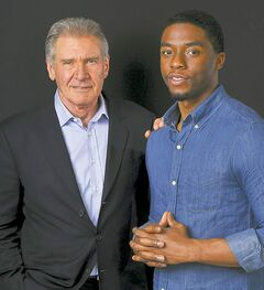 In this Saturday, March 23, 2013 photo, Harrison Ford. left, and Chadwick Boseman, cast members in the new film