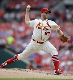 St. Louis Cardinals starting pitcher Justin Masterson throws during the first inning in the first baseball game of a doubleheader against the Chicago Cubs Saturday, Aug. 30, 2014, in St. Louis. (AP Photo/Jeff Roberson)