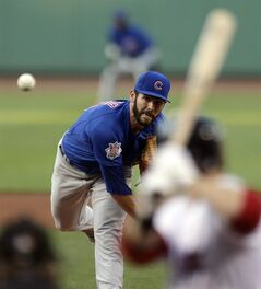 Chicago Cubs starting pitcher Jake Arrieta delivers against the Boston Red Sox during the first inning of a baseball game at Fenway Park in Boston, Monday, June 30, 2014. (AP Photo/Charles Krupa)