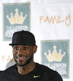 Cleveland Cavaliers' LeBron James smiles as he answers questions during a news-conference before the homecoming event at InfoCision Stadium on Friday, Aug. 8, 2014, in Akron, Ohio. (AP Photo/Tony Dejak)