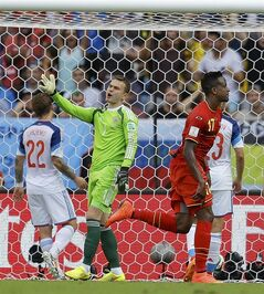 Russia's goalkeeper Igor Akinfeev (1) reacts after Belgium's Divock Origi (17) scored his side's first goal during the group H World Cup soccer match between Belgium and Russia at the Maracana Stadium in Rio de Janeiro, Brazil, Sunday, June 22, 2014. (AP Photo/Natacha Pisarenko)