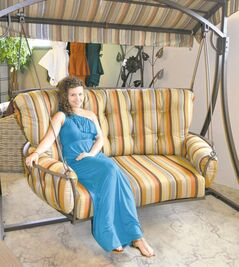 Sales associate Brooke Van Ryssel on patio swing at Wicker World.