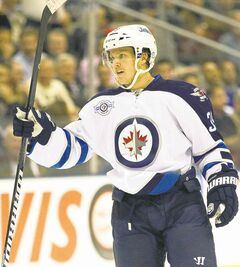 Winnipeg Jets defenceman Tobias Enstrom celebrates his goal against the Toronto Maple Leafs during first period NHL action in Toronto on Wenesday October 19, 2011.