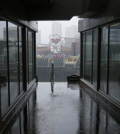 Rain falls in the stands and into the concourses as the Minnesota Twins baseball game against the Detroit Tigers in Minneapolis, Sunday, April 27, 2014, is postponed due to the weather. (AP Photo/Ann Heisenfelt)