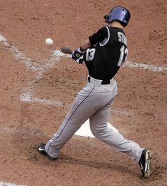 Colorado Rockies' Drew Stubbs (13) hits a two-run home run during the seventh inning of a baseball game against the Kansas City Royals Wednesday, May 14, 2014 in Kansas City, Mo. (AP Photo/Charlie Riedel)