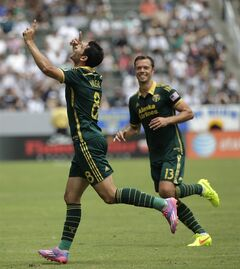 Portland Timbers' Diego Valeri, left, of Argentina, celebrates his goal with Jack Jewsbury during the first half of an MLS soccer match against the Los Angeles Galaxy on Saturday, Aug. 2, 2014, in Carson, Calif. (AP Photo/Jae C. Hong)