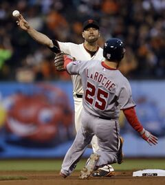 San Francisco Giants second baseman Brandon Hicks throws over Washington Nationals' Adam LaRoche to complete a double play in the fourth inning of a baseball game Tuesday, June 10, 2014, in San Francisco. Washington's Ryan Zimmerman was out at first base. (AP Photo/Ben Margot)